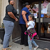 (Brad Davis/The Register-Herald) Raleigh County voters Alea Simms, left, and her mother Crotia Washington enter their precinct at Stratton Elementary with young Asia Washington in tow Tuesday afternoon in Beckley.