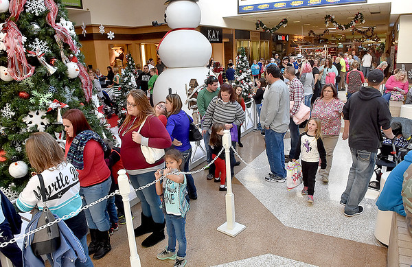 (Brad Davis/The Register-Herald) The line to meet Santa Claus on his first appearance of the year stretched throughout the Crossroads Mall Saturday afternoon.