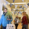 (Brad Davis/The Register-Herald) Customers navigate the halls of the Grant Building as they shop the various booths inside during the first ever Small Business Saturday shopping event yesterday in Uptown Beckley.