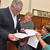 (Brad Davis/The Register-Herald) From left, House of Delegates 30th district candidate Mick Bates, his daughter Clare and Beckley City Councilwoman Sherrie Hunter comb through incoming results Tuesday night at the Raleigh County Courthouse.