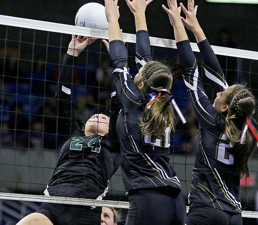 (Brad Davis/The Register-Herald) Fayetteville's Kendall Malay leaps to return the ball against Williamstown during the Pirates' opening round game in the class A State Volleyball Tournament Friday morning at the Charleston Civic Center.