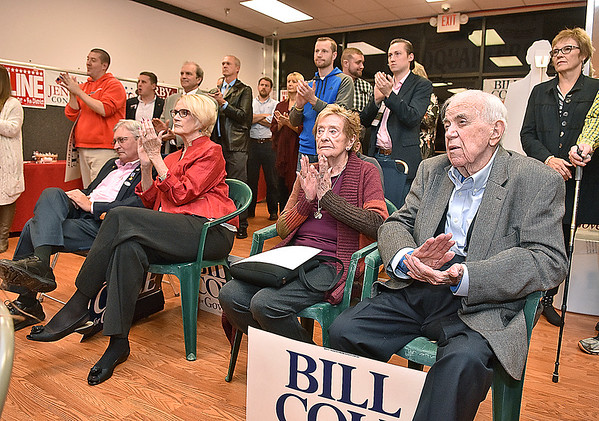 (Brad Davis/The Register-Herald) Supporters applaud as state republicans speak during a rally at gubernatorial candidate Bill Cole's election headquarters in the Cranberry Shopping Center Sunday night.