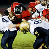 Evan Dillon of Oak Hill is lifted off the ground by Mikah Vines of Shady Spring but not until after Dillon got the first down for the Red Devils. Chad Foreman for the Register-Herald