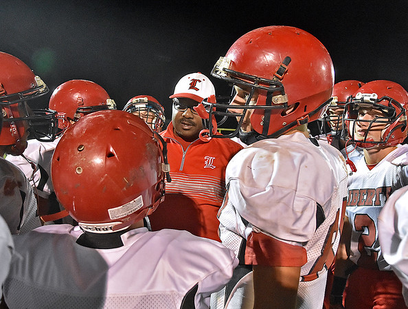 (Brad Davis/The Register-Herald) Liberty players and coaches come together to try and find a way back into the game prior to the start of the second half of the Raiders' road game at Independence Friday night in Coal City.