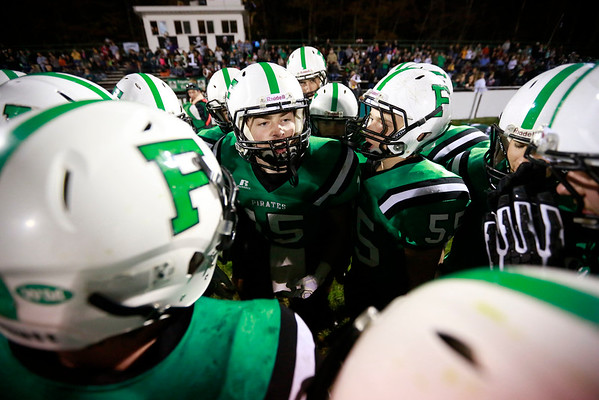 Fayetteville's Alex Hewitt (15) pumps his teammates up prior to kickoff of their football game against Greenbrier West Friday in Fayetteville. (Chris Jackson/The Register-Herald)