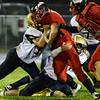 Christian Lively is gang tackeled as he runs the ball for the Oak Hill Red Devils. Chad Foreman for the Register-Herald