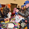 (Brad Davis/The Register-Herald) Riders (from left) Dewayne Howard of Springfield, Missouri, Terry Sharp of Fenton, Missouri, along with Ann and John Stamb of Stafford, Virginia get to work organizing donated winter clothing during the opening moments of a Run For The Wall coat and winter clothing giveaway at Rainelle Elementary School Saturday afternoon.