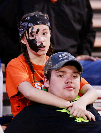 Summers County fans Aleigha Clemmer, 16, and Noah Brown, 17, look on prior to kickoff of their game against Webster County Friday in Hinton. (Chris Jackson/The Register-Herald)