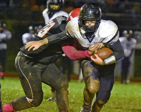 (Brad Davis/The Register-Herald) James Monroe's Grant Mohler carries the ball during the Mavericks' win over Liberty Friday night in Glen Daniel