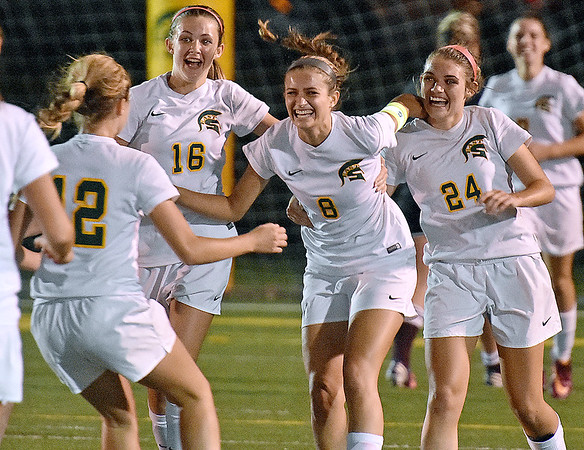 (Brad Davis/The Register-Herald) Greenbrier East's Mallory Baker is mobbed by teammates after scoring her second goal of the game in the win over Woodrow Wilson Thursday night in Fairlea.