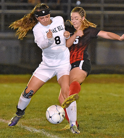 (Brad Davis/The Register-Herald) Oak Hill's Julia Ivey battles for possesion with PikeView's #15 Wednesday night in Oak Hill.