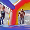 (Brad Davis/The Register-Herald) Four-year-olds Landry Gwinn, left, and Jordan Justice jump away the morning inside a giant inflatable during a Family Fun Day event at Mountaineer Automotive Saturday morning.