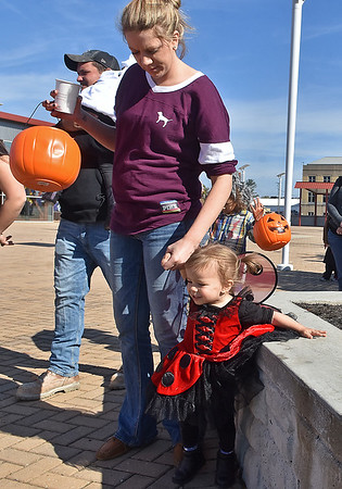 (Brad Davis/The Register-Herald) Fayetteville's Ashley and 1-year-old ladybug Piper during Tailgate Halloween Saturday morning.