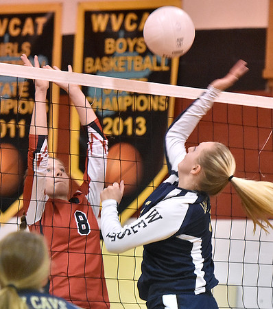 (Brad Davis/The Register-Herald) Greenbrier West's Alexis Vestal leaps to hit the ball as Greater Beckley Christian's Abby Hill tries to block it Wednesday night in Prosperity.