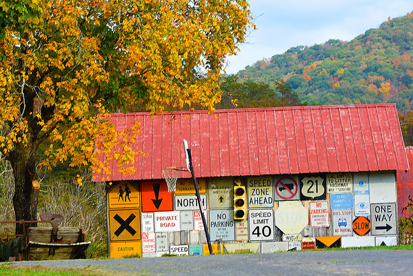 Scenic view of a garage with street signs located near Greenville off of Route 122 in Monroe County.