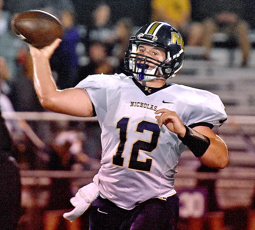 (Brad Davis/The Register-Herald) Nicholas County quarterback Tate Mays throws during the Grizzlies' road win over the Mavericks Friday night in Lindside.