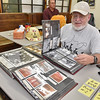 (Brad Davis/The Register-Herald) History buff and railroad enthusiast John Sherwood can't pull himself away from albums of historic photographs inside the museum during Railroad Days in Hinton Sunday afternoon.