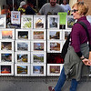 (Brad Davis/The Register-Herald) Illinois resident Deb McCutcheon browses spectacular railroad photographs for sale at the booth of photographers Loyd Lowry and Steven Nicely Jr. during Railroad Days in Hinton Sunday afternoon.