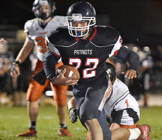 (Brad Davis/The Register-Herald) Independence's Noah Adams rumbles ahead during the Patriots' win over Summers County Friday night in Coal City.