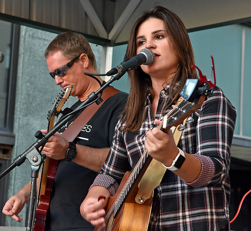 (Brad Davis/The Register-Herald) Coal City native Krista Hughes and company provide some live entertainment during Chili Night Saturday evening in uptown Beckley.