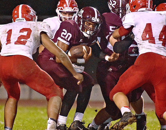 (Brad Davis/The Register-Herald) Woodrow Wilson's Micah Hancock can't find a lane as he's surrounded by Parkersburg defenders during the Flying Eagles' home game against the Big Reds Friday night.
