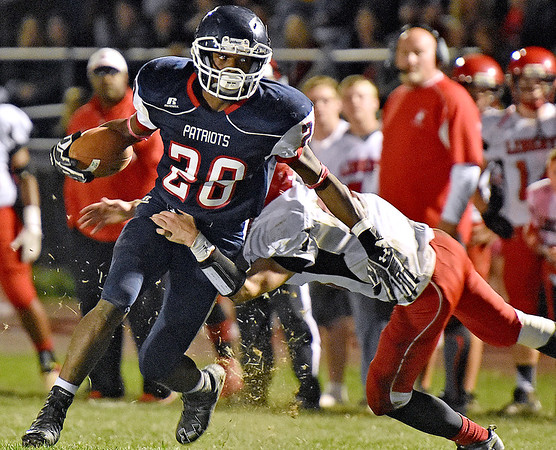 (Brad Davis/The Register-Herald) Independence running back Marcus Guy shakes a tackle from Liberty defender Robert Dickens as he carries the ball during the Patriots' win over the Raiders Friday night in Coal City.