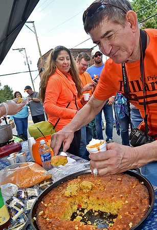 (Brad Davis/The Register-Herald) Greg Miklasiewicz gets a big slab of cornbread for his chili during the Fayetteville Chili Cook-Off Saturday afternoon on Court Street.