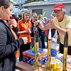 (Brad Davis/The Register-Herald) Retired science teacher and festival launch technician Henry Bobbin, right, helps a group of visiting Virginia Tech Engineering students prepare rockets they brought along for launch Saturday afternoon.