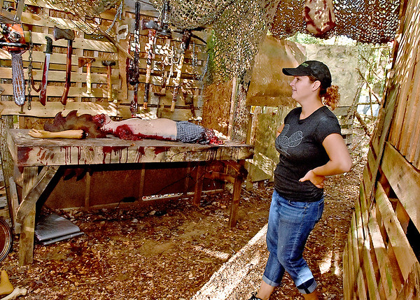(Brad Davis/The Register-Herald) Ashley Davis-Long, Creative Director at The Resort at Glade Springs, shows sections of this year's layout for Fright Nights Wednesday evening. Davis said she thinks this year's Fright Night, the seventh annual edition, will be their best one yet.