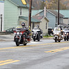 (Brad Davis/The Register-Herald) Riders make their way into Rainelle for a lap through town before stopping for a Run For The Wall coat and winter clothing giveaway at Rainelle Elementary School Saturday afternoon.