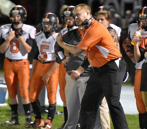(Brad Davis/The Register-Herald) Summers County head coach Nate Tanner instructs his team during the Bobcats' road game at Indy Friday night.