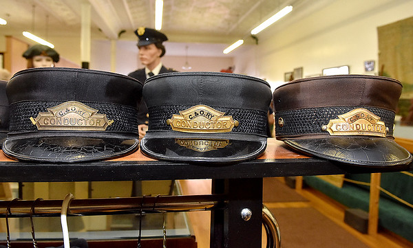 (Brad Davis/The Register-Herald) Old conductor's hats sit on display inside the Railroad Museum during Railroad Days in Hinton Sunday afternoon.