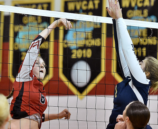 (Brad Davis/The Register-Herald) Greater Beckley Christian's Abby Hill hits the ball as Greenbrier West's Rachel Adkins tries to block it Wednesday night in Prosperity.