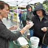 (Brad Davis/The Register-Herald) Lewisburg resident Diana Godbey, right, gets a cup of Bacon Scallop Chowder from Food & Friends' Amy Barfield during Taste of Our Town Saturday afternoon in Lewisburg.