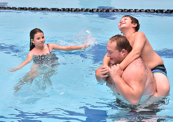 (Brad Davis/The Register-Herald) Eight-year-old Bethany Sturgill and her 11-year-old brother Josh spend a day splashing around in the pool with their uncle Eric Ricketts inside the YMCA of Southern West Virginia during an open house weekend Sunday afternoon.
