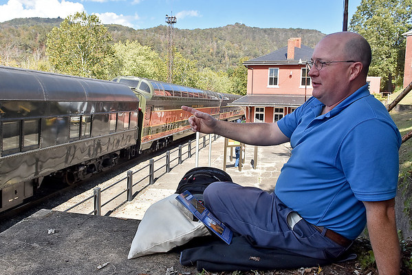 (Brad Davis/The Register-Herald) Prince Edward Island, Canada resident Andy Black relaxes at the depot for a while as he waits to board the New River Train for its return trip to Huntington during Railroad Days in Hinton Sunday afternoon.