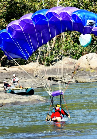 Base jumper lands in the New River after jumping off the New Gorge Bridge during Bridge Day in Fayetteville.<br /> (Rick Barbero/The Register-Herald)