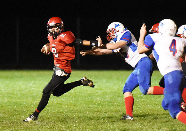 Liberty's Jacob Bailey (8) slips away from Matthew Skaggs (85) during the first quarter of their game Friday in Glen Daniel. (Chris Jackson/The Register-Herald)