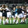 Woodrow Wilson's girls soccer team crowd around their goalkeeper Kylie Johnson (5) after Madison Chandler (28) scored their last penalty kick during penalty kicks following their double overtime victory in their Class AAA, Region 3, Section 1 Tournament game against Princeton in Beckley on Tuesday. (Chris Jackson/The Register-Herald)