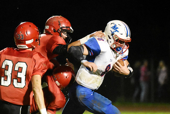 Midland Trail's Thomas Ferris (8) slips away from two Liberty defenders in route for a touchdown run during the first quarter of their football game Friday in Glen Daniel. (Chris Jackson/The Register-Herald)