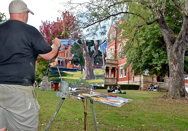 (Brad Davis/The Register-Herald) Clarksburg artist Seth Hill paints the scene in front of him during the New River Plein Air Art Festival going on around Fayetteville's Bridge Day Chili Cook-off Saturday.