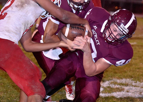 (Brad Davis/The Register-Herald) Woodrow Wilson's Colton Wright is stripped of the ball during the Flying Eagles' home game against the Big Reds Friday night.