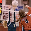 (Brad Davis/The Register-Herald) Greenbrier West's Alexis Vestal leaps to try and block a hit from Greater Beckley Christian's Abby Hill Wednesday night in Prosperity.