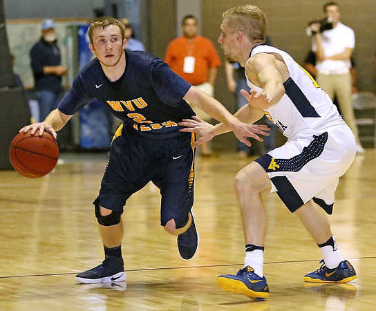 (Brad Davis/The Register-Herald) WVU Tech's Will Fox drives up the court during the Mountaineers' exhibition game with the Golden Bears Saturday night at the Beckley-Raleigh County Convention Center.