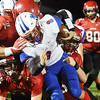 Midland Trail's Thomas Ferris (8) is tackled by several Liberty defenders during the first quarter of their game Friday in Glen Daniel. (Chris Jackson/The Register-Herald)