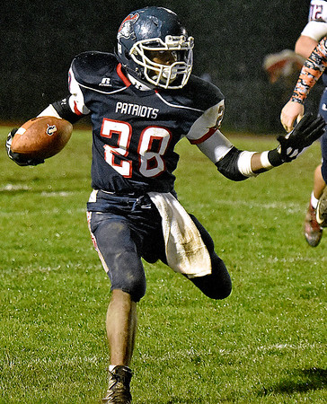 (Brad Davis/The Register-Herald) Independence's Marcus Guy carries the ball during the Patriots' win over Summers County Friday night in Coal City.