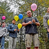(Brad Davis/The Register-Herald) A group of fathers, grandfathers, brothers and any other male family members of infants lost before, during or shortly after birth observe a moment of silence and release balloons as their names are read aloud one at a time during a memorial walk and vigil Saturday evening at Lake Stephens as part of National Pregnancy and Infant Loss Awareness month around the country.