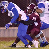 (Brad Davis/The Register-Herald) Woodrow Wilson's Jordan Hancock makes a tackle during the Flying Eagles' game against Capital Friday night at Van Meter Stadium.