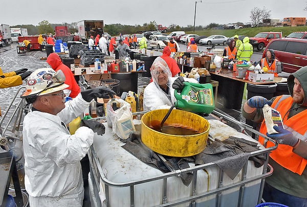 (Brad Davis/The Register-Herald) An army of workers sort and dispose of hundreds of different types of hazardous chemicals and materials during the Beckley Area Foundation's Hazardous Waste Drop-off Saturday morning at the Beckley-Raleigh County Convention Center.