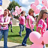 (Brad Davis/The Register-Herald) Valley College students and others make their way into Jim Word Memorial Park to release over a hundred pink balloons into the air during a breast cancer awareness month event Wednesday afternoon Around 25 students and a few firefighters from Mt. Hope and Clear Creek fire departments made the walk all the way from the school's location beside Ollie's, up Kanawha Street to the park and released a balloon for each friend or family member affected by the disease.